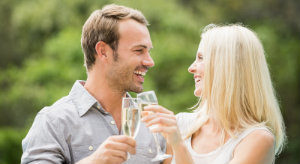 couple laughing and toasting with champagne