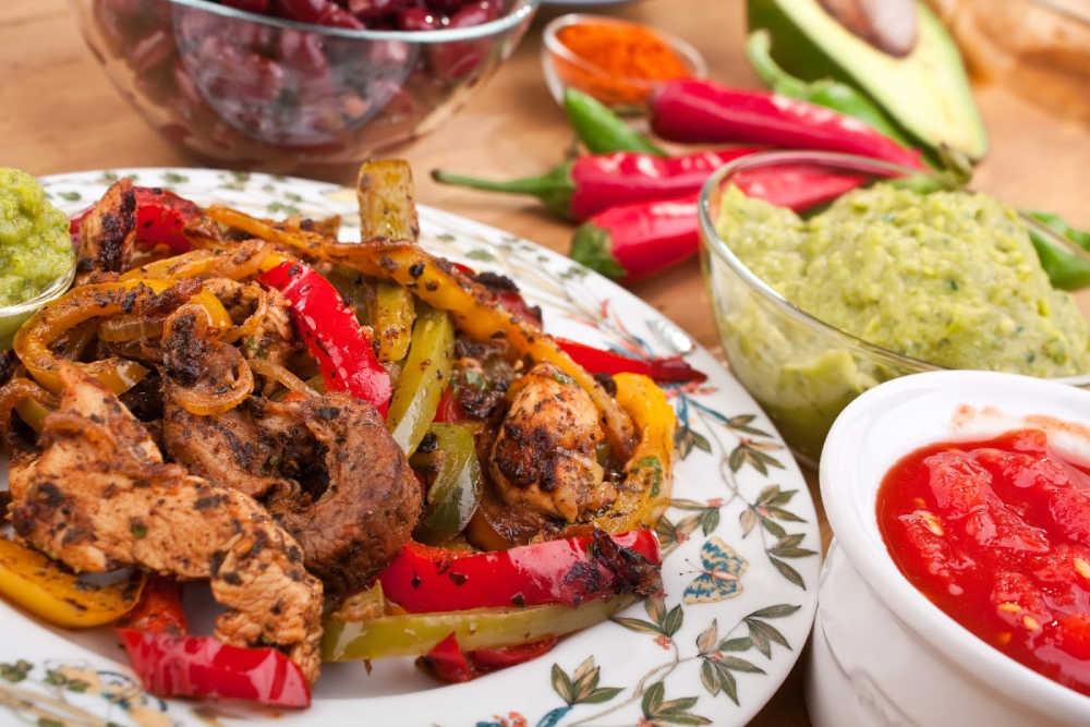 Tex-Mex food chicken fajitas with salsa and guacamole