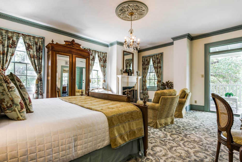 Luxurious guest room is San Antonio at Noble Inns with accents of green